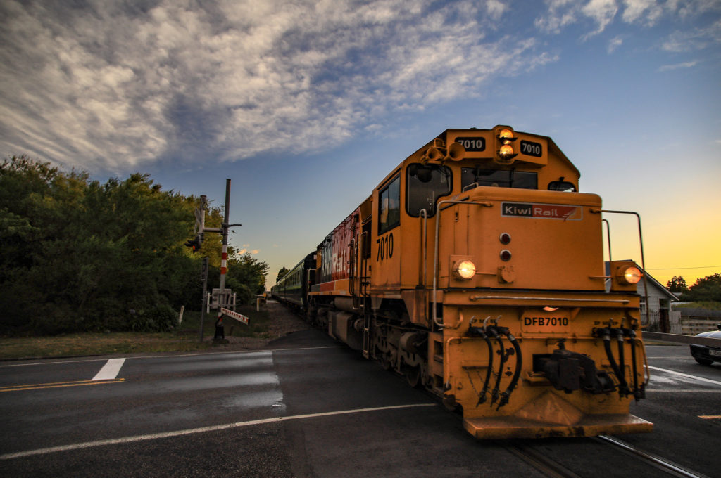 LOCOMOTIVE AT FEATHERSTON LEVEL CROSSING. PHOTO BY PETE MONK.
